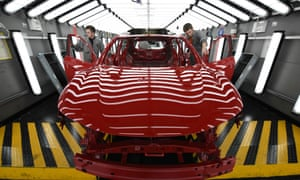 Nissan workers inspect a Qashqai model at the firm's Sunderland plant