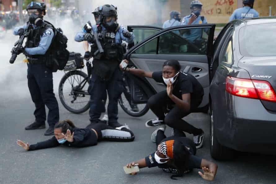 Police order motorists to the ground in South Washington Street, Minneapolis, on Sunday.