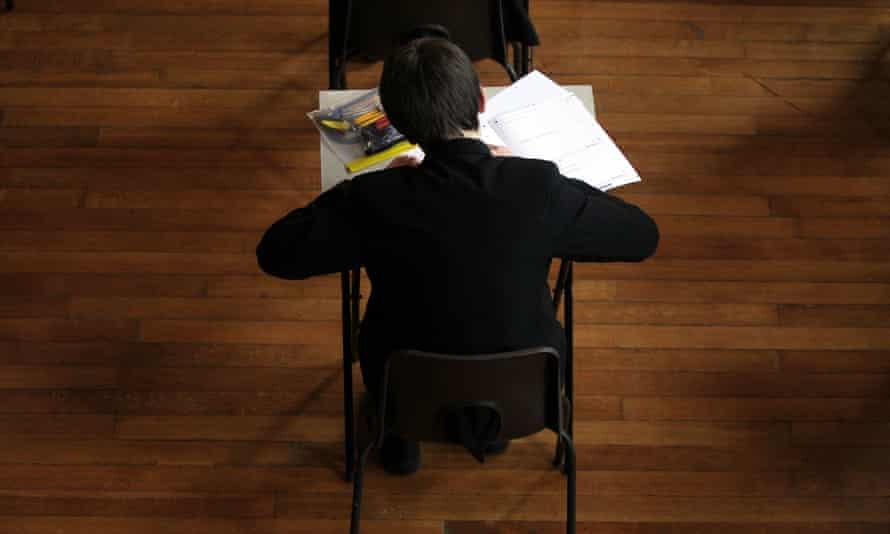 Pupil at school uniform sitting an exam