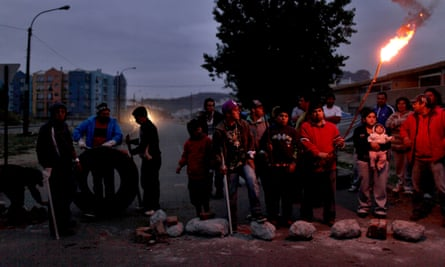 Residents in Concepción guard their homes against looters after the 2010 quake.