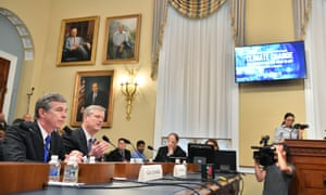 Governor Roy Cooper of North Carolina and Governor Charlie Baker of Maryland testify during a House natural resources committee hearing on climate change on Wednesday.