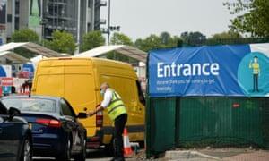 Cars entering a drive-in coronavirus testing centre in Twickenham, London, today.