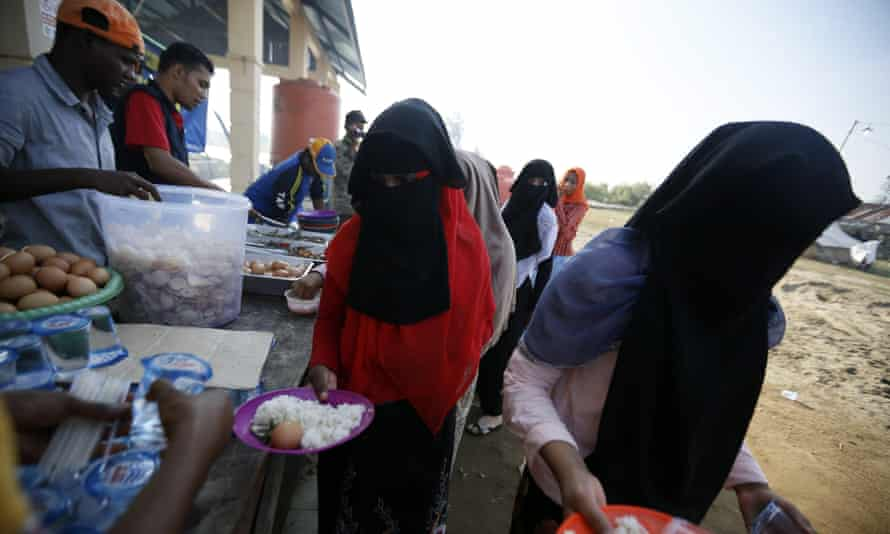 Rohingya refugees queue for breakfast at their temporary camp in Kuala Cangkoi, North Aceh, Indonesia, in June 2015.