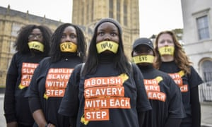 Girls prepare to take part in the 'Walk for Freedom' protest against modern slavery, in London on 14 October 2017.