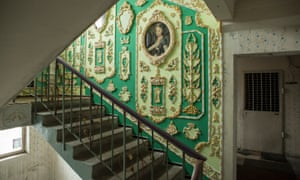 Plaster mouldings and paintings in the stairwell