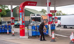 A member of staff tapes off the petrol pump area at the Esso petrol station on the A40 Oxford Road in Denham after they ran out of fuel today