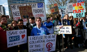 Junior doctors and supporters hold placards during a strike outside St Thomas' Hospital in London.