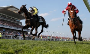 Tiger Roll, right, just holds off Pleasant Company in last year's Grand National.