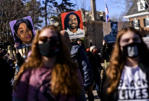 Minnesota, US: people hold portraits of Breonna Taylor, Philando Castile and Elijah McClain during a protest outside the governor's residence in St Paul. A number of protests are scheduled in the days before jury selection begins in the trial of former Minneapolis police officer Derek Chauvin