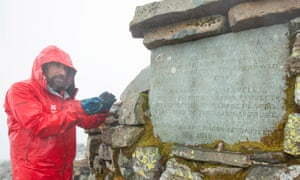National Trust ranger Iain Gray works on rebuilding the summit cairn and war memorial at Scafell Pike.