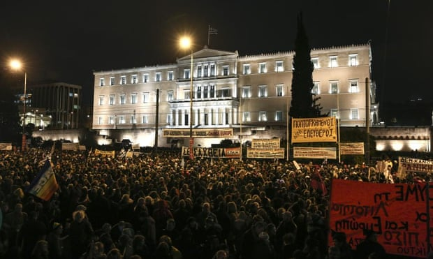 Pro-government protesters gathered in front of Greece's parliament to back its demands of a bailout debt renegotiation tonight.