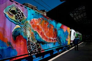 Noah's Train, a 200-metre freight train with wagons designed by street artists, at the Principe Pio train station in Madrid, Spain