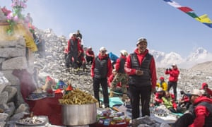 Guides and climbers at Everest base camp in a film still from Sherpa