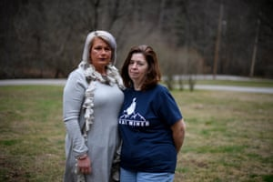 Stephanie Bentley, 44, and Linda Adams, 57, both black lung widows stand outside Bentley's home in Virgie, Kentucky.