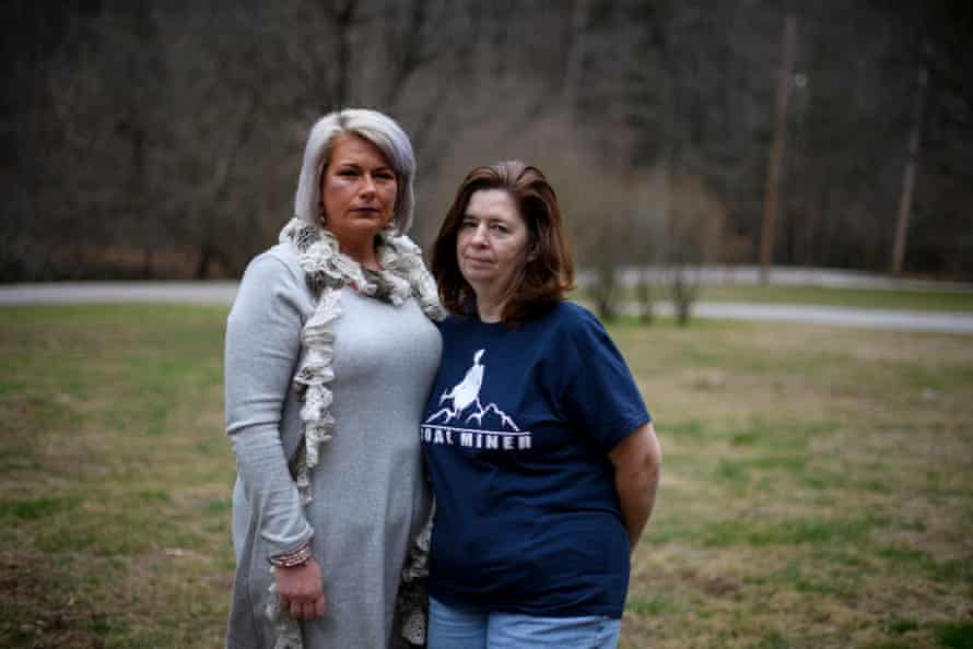 Stephanie Bentley, 44, and Linda Adams, 57, both black lung widows stand outside Bentley's home in Virgie, Kentucky.