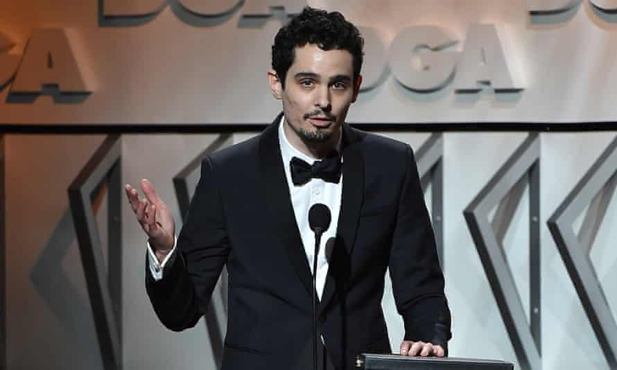 Damien Chazelle accepts the his award for outstanding directorial achievement for La La Land at the DGA awards on Saturday.