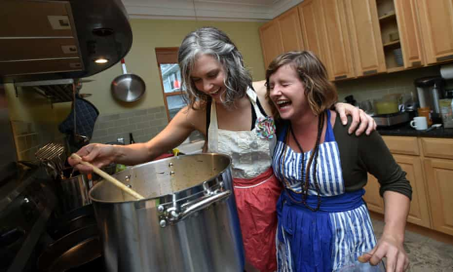 Communal HousingSarah Cabell (L) and Kailey-Jean Clark (R) cook together at Euclid Manor, a 6,200 sqft co-living house with 11 roommates in Oakland, California on March 13, 2016. The commune's residents maintain a theme of social impact, creativity and positive change.