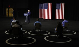 Socially distanced reporters cover Biden's campaign event in Wilmington, Delaware on Tuesday.