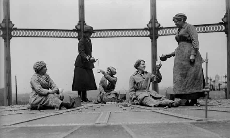 Women workers at the Gas Light and Coke Company at Bromley By Bow, London, serving tea on top of a gasometer in 1918.