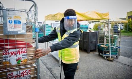 Marcus Rashford pulling crate of food at FareShare depot