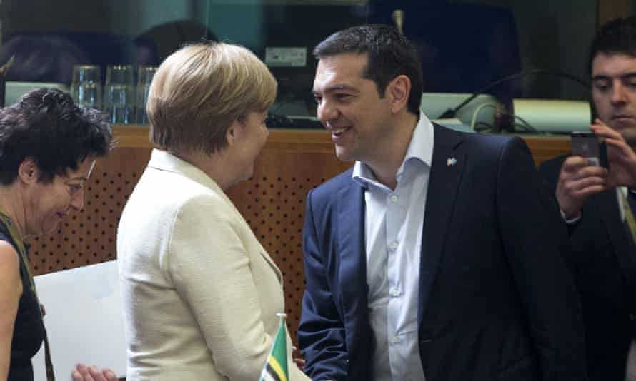 German Chancellor Angela Merkel (left) shakes hands with Greek Prime Minister Alexis Tsipras in Brussels.