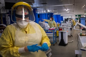 London, UK. A nurse wearing PPE works in the intensive care unit in St George's hospital in Tooting, south-west London, where the number of intensive care beds for the critically sick has had to be increased from 60 to 120, the vast majority of which are for coronavirus patients. With cases continuing to rise across the country, staff at the hospital, one of England's largest, say they are working 'to the limit' of their ability, with exhausting shift patterns, and the prospect that the worst is still to come