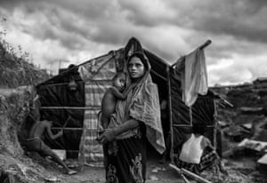 A Rohingya woman and child outside their shelter at the sprawling Balukali refugee camp