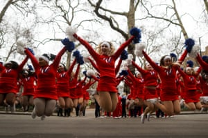 Cheerleaders jump in the air as they perform during the new year's day parade in London