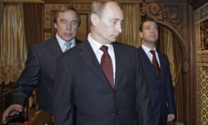 Sergei Roldugin, Vladimir Putin and Dmitry Medvedev, then Russian president, tour the House of Music in St Petersburg in 2009