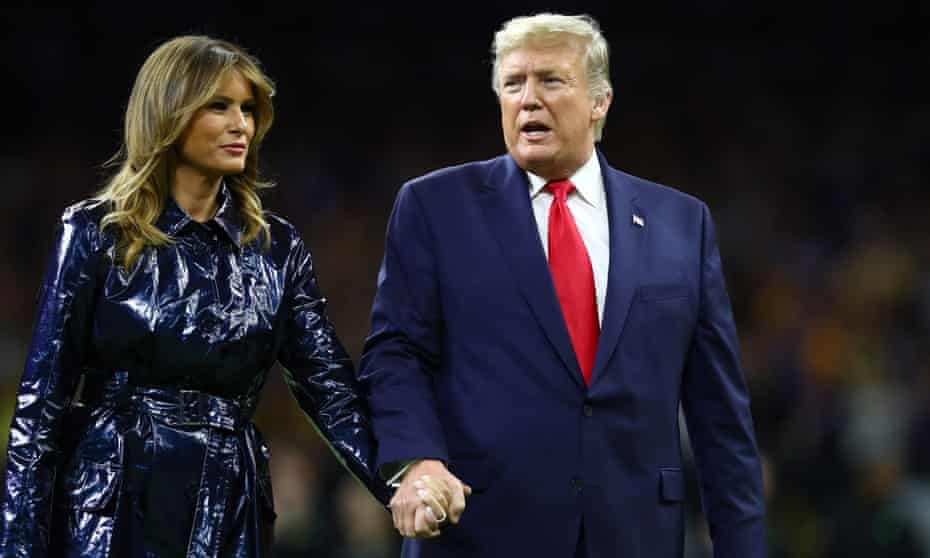 Donald and Melania Trump exit the pitch before a college football play-off game between Clemson and Louisiana State, January 2020.