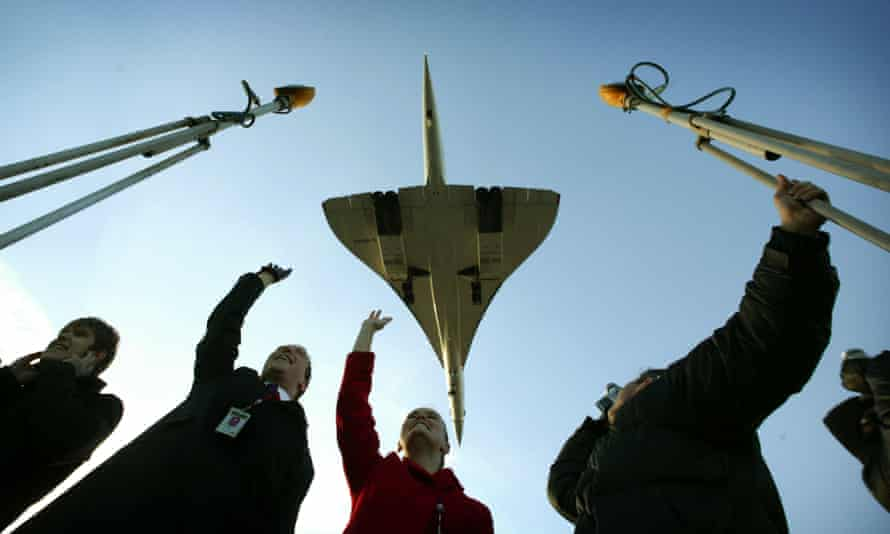 Waving to Concorde as it comes in to land at Heathrow.