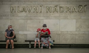 People wearing protective face masks wait for train at metro station in Prague, Czech Republic, on 1 July
