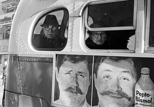 Billboard and passengers on New York bus, NY, USA, 1963