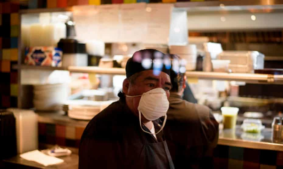 A restaurant cook at Arnaldo Richards' Picos in Houston in May. Private businesses can tell customers to wear masks, but unlike earlier this year, they have no statewide mandate to back them up.