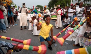 Dayana Dupliro, five, dances to the sounds of a female <em>rara</em> band in Port-au-Prince during the 'Carnival of Flowers' a three-day celebration President Michel Martelly has revived from the Duvalier era.