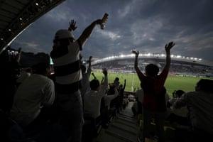 Fans enjoy the match between Canada and Italy at Fukuoka Hakatanomori Stadium.