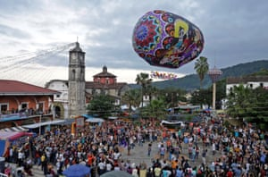 Puebla, Mexico Attendees admire a Cantoya balloon during the International Festival of Paper Artistic Balloons in Tuzamapan