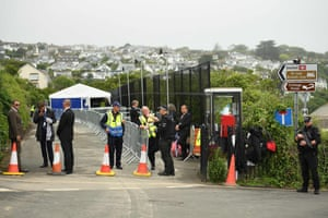 Officers stand guard in Carbis Bay