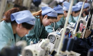 Workers sew clothes at a garment factory in Huaibei city. The recent slowdown in Chinese manufacturing has deepened fears for the economy.