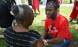 Democratic gubernatorial candidate Andrew Gillum talks with a supporter after speaking to voters and public school teachers at a rally in Miami Gardens, Florida.