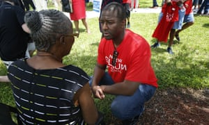 Andrew Gillum talks with a supporter after speaking to voters and public school teachers at a rally in Miami Gardens in August.