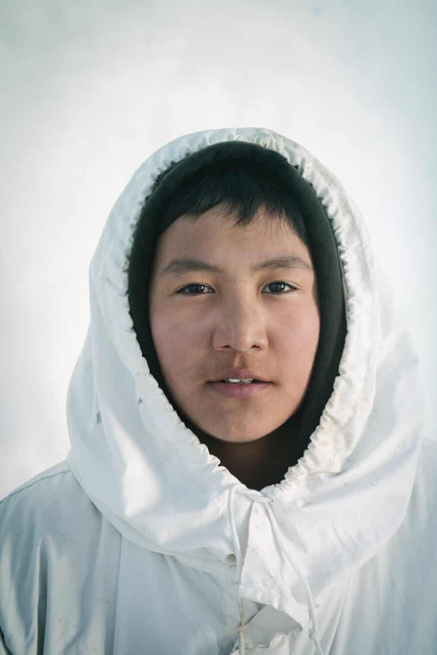 16-year old Yugu Ningeok, a member of an Iñupiaq whaling crew, wears his ice camoflauge cover, or qatiginisi. Yugu is named after his uncle, the original founder of the whaling crew.