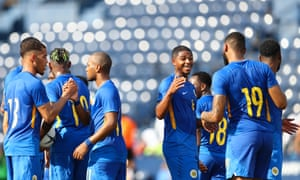 Curaçao players celebrate together during the recent win over India in Buri Ram, Thailand.