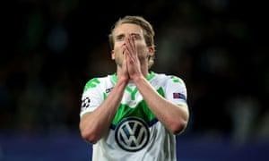 Wolfsburg's striker Andre Schurrle reacts.