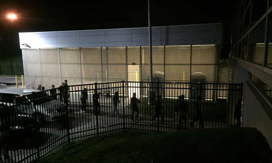 Detainees are escorted into an Ice facility in Brooklyn Heights, Ohio, on 20 June after over 140 workers were arrested at the Fresh Mark meatpacking plant.