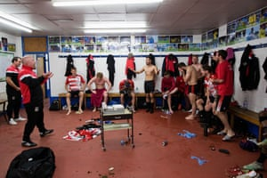 Manager Craig Edwards talks to the players for the final time in the dressing room at Kingsmeadow.