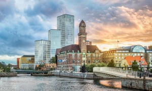Beautiful cityscape with sunset over canal and skyline in Malmo, Sweden.