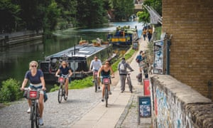 Cyclists and pedestrians share the path by Regent's Canal in London