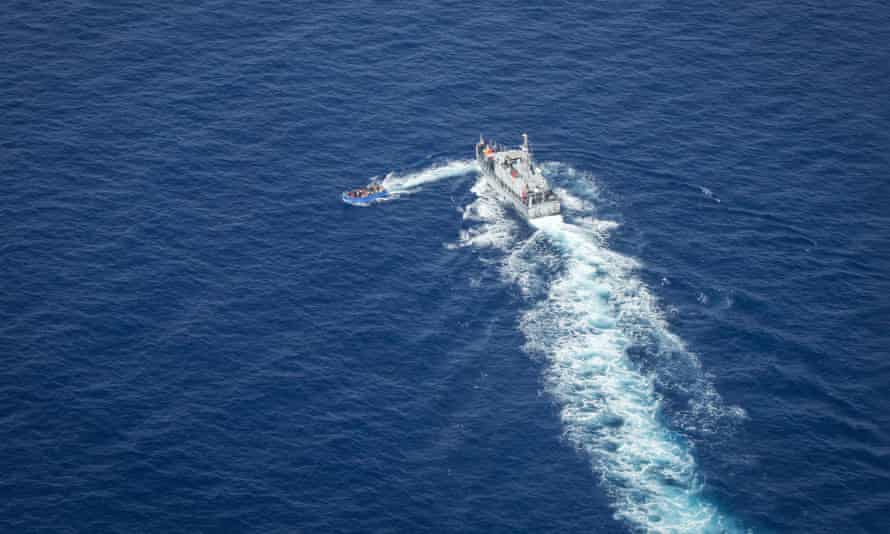 This aerial image taken on 30 June shows Libyan coastguards near a migrant boat in the Malta search and rescue zone. Footage showed the patrol boat apparently firing at the smaller boat