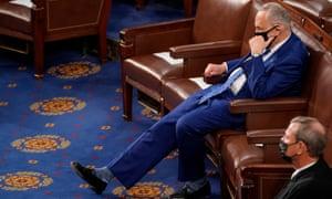 The Senate majority leader Chuck Schumer listen as Joe Biden speaks.